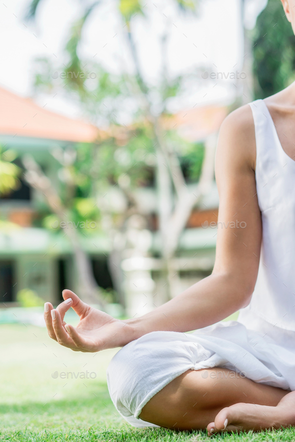 Yoga on the lawn - Stock Photo - Images