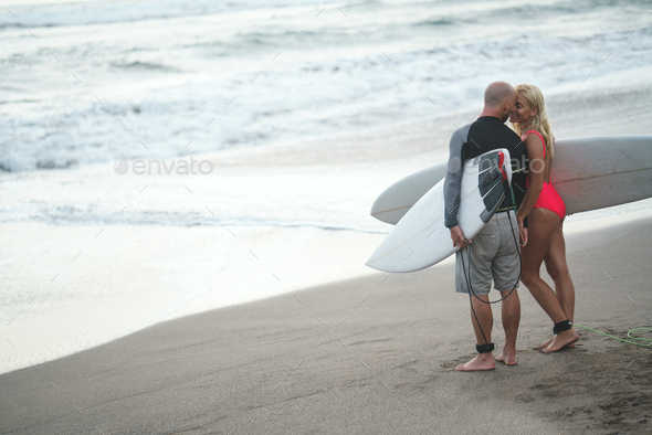 Surfing couple - Stock Photo - Images