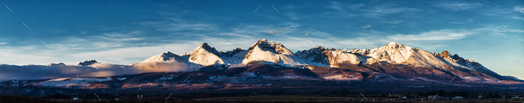 Panoramic shot of winter mountain landscape during sunset. High - Stock Photo - Images