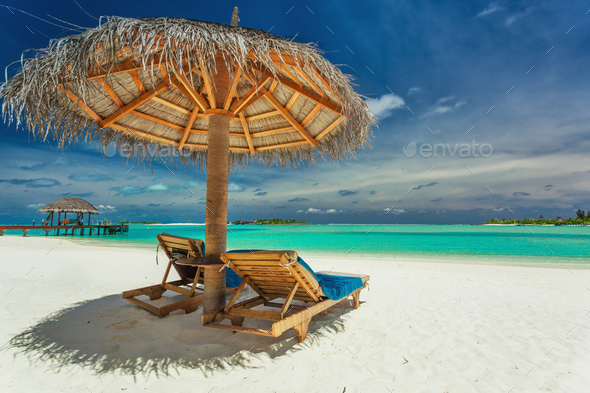 Two chairs and umbrella on stunning tropical beach, Maldives - Stock Photo - Images