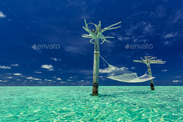Empty hammock in the middle of tropical lagoon, Maldives - Stock Photo - Images