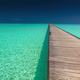 Wooden long jetty over lagoon with amazing clean azure water - PhotoDune Item for Sale
