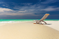 Tropical beach view of amazing water and empty chair on sand for - PhotoDune Item for Sale