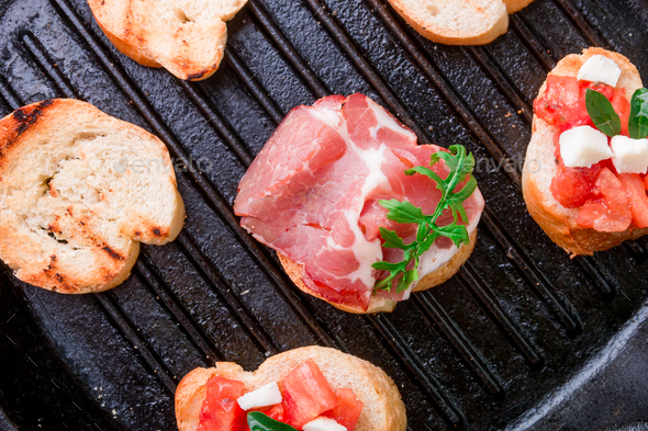 Toast on grill pan. Set of crostini - Stock Photo - Images