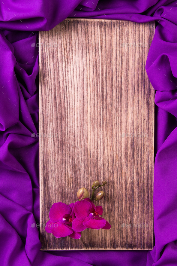 Purple orchid on wooden background. - Stock Photo - Images