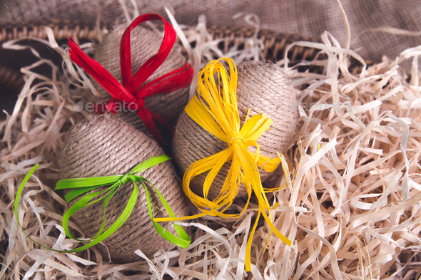 Easter. White eggs in purple basket - Stock Photo - Images