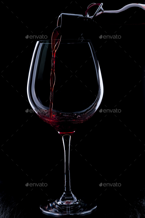Red wine pouring - Stock Photo - Images