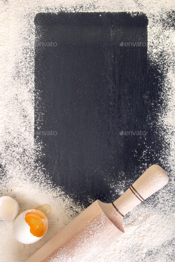 Book for recipe around utensils and flour - Stock Photo - Images