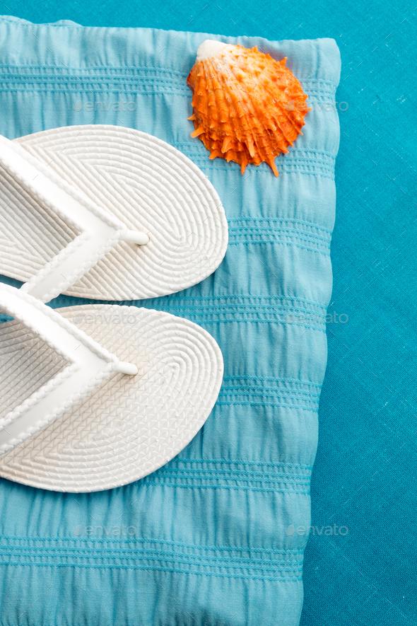 White flip flop near seashell - Stock Photo - Images