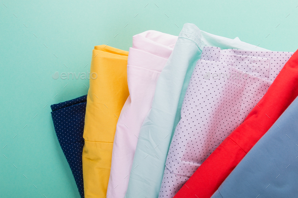 Stack of bright female trousers. - Stock Photo - Images