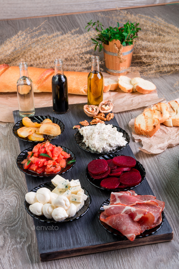 Ingredients on plate for preparation bruschetta - Stock Photo - Images