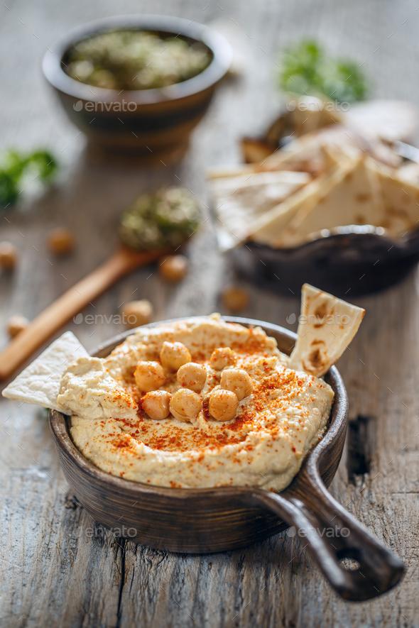 Creamy homemade hummus - Stock Photo - Images