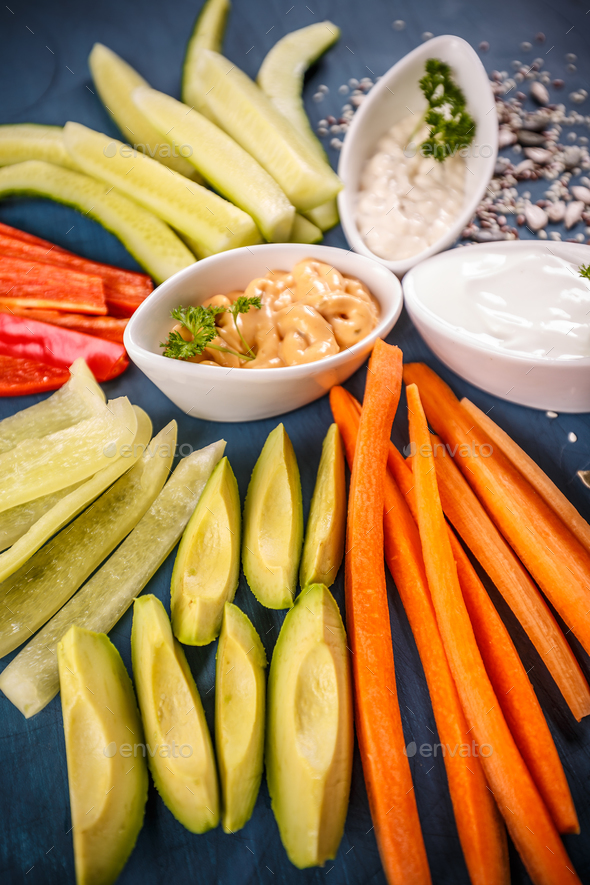 Colorful slices of raw vegetables - Stock Photo - Images