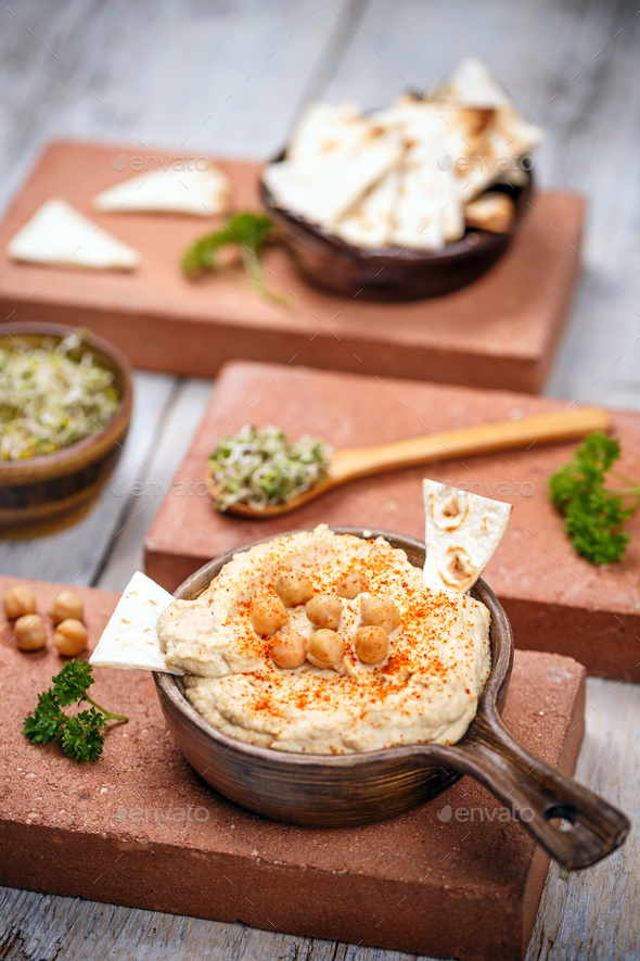 Hummus with pita chips - Stock Photo - Images