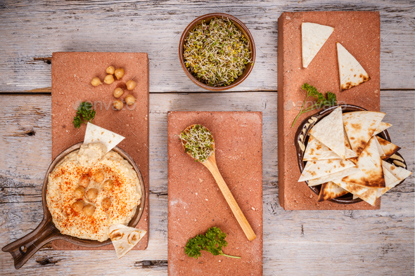 Hummus served with pita and sprout - Stock Photo - Images
