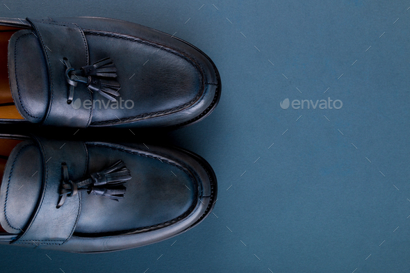 Blue loafer shoes on blue background. - Stock Photo - Images