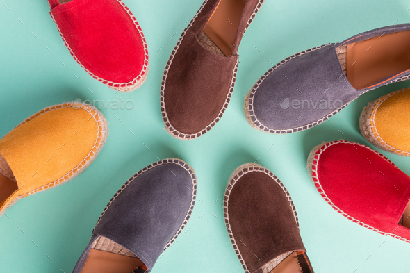 Four pair of espadrilles on multicolor - Stock Photo - Images