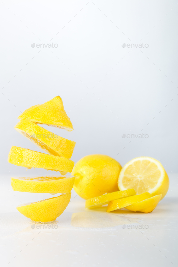 Flying lemon. Sliced lemon - Stock Photo - Images
