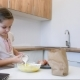 Little Girl Learns To Cook in the Kitchen and Make Bakery Using Laptop - VideoHive Item for Sale