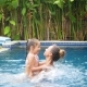 Happy Mother and Her Daughter Have Fun in Swimming Pool - VideoHive Item for Sale