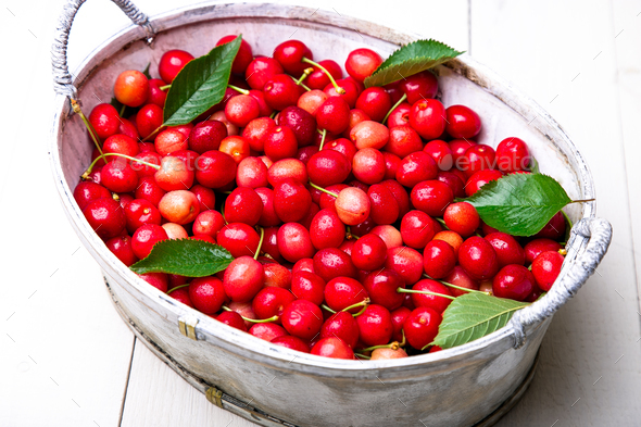 Red cherries in white basket - Stock Photo - Images