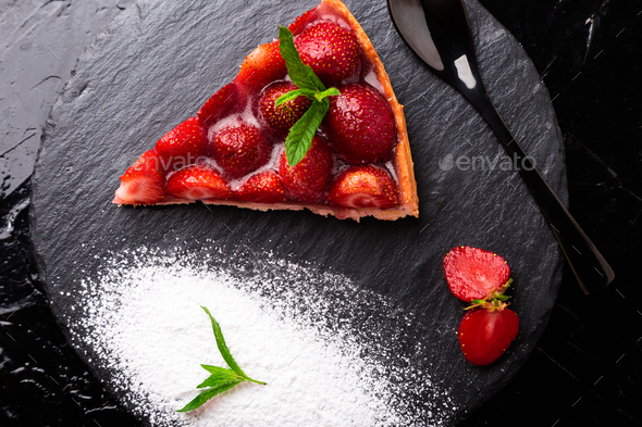 Strawberry pie on black slate plate. - Stock Photo - Images