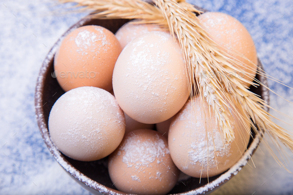 Fresh eggs in a brown bowl - Stock Photo - Images