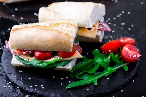Sandwich with jamon, arugula, tomatoes - Stock Photo - Images
