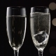 Two Flutes of Champagne with Transparent Pieces of Ice on the bottom Bokeh Blinking Black Background - VideoHive Item for Sale