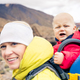 Super mother hiking with baby travelling in backpack - PhotoDune Item for Sale