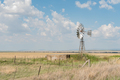 Farm scene with water-pumping windmill between Verkeerdevlei and Excelsior - PhotoDune Item for Sale