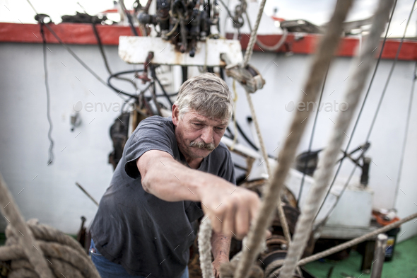 Deckhand doing hard work - Stock Photo - Images