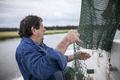 Deckhand mending nets - PhotoDune Item for Sale
