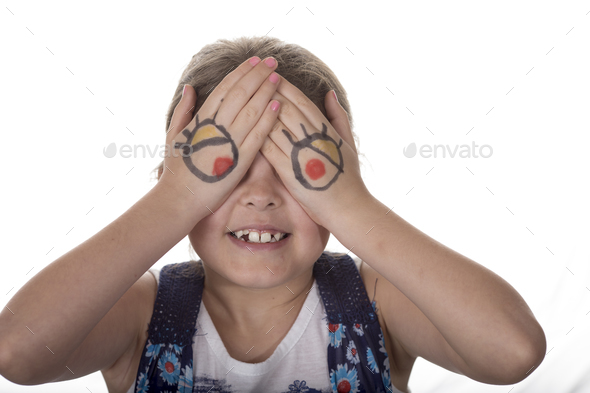 Little girl with cartoon eyes painted on her hands making goofy - Stock Photo - Images