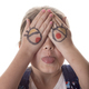 Little girl with cartoon eyes drawn on hands making goofy face. - PhotoDune Item for Sale