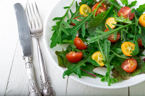 Vegetarian arugula salad with kumquat - Stock Photo - Images