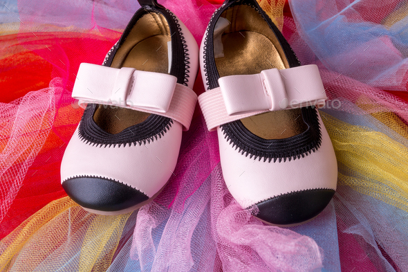 Baby girl pink shoes on colored - Stock Photo - Images
