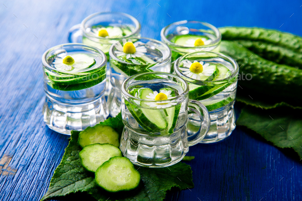 Cucumber water in six little mason glass - Stock Photo - Images