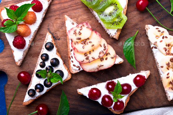 Fruit toast on wooden board - Stock Photo - Images