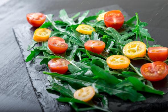 Vegetarian arugula salad with kumquat - Stock Photo - Images
