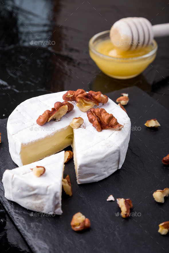 Cheese camembert with walnuts - Stock Photo - Images