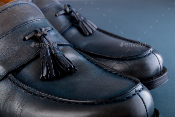 Blue loafer shoes on blue background - Stock Photo - Images