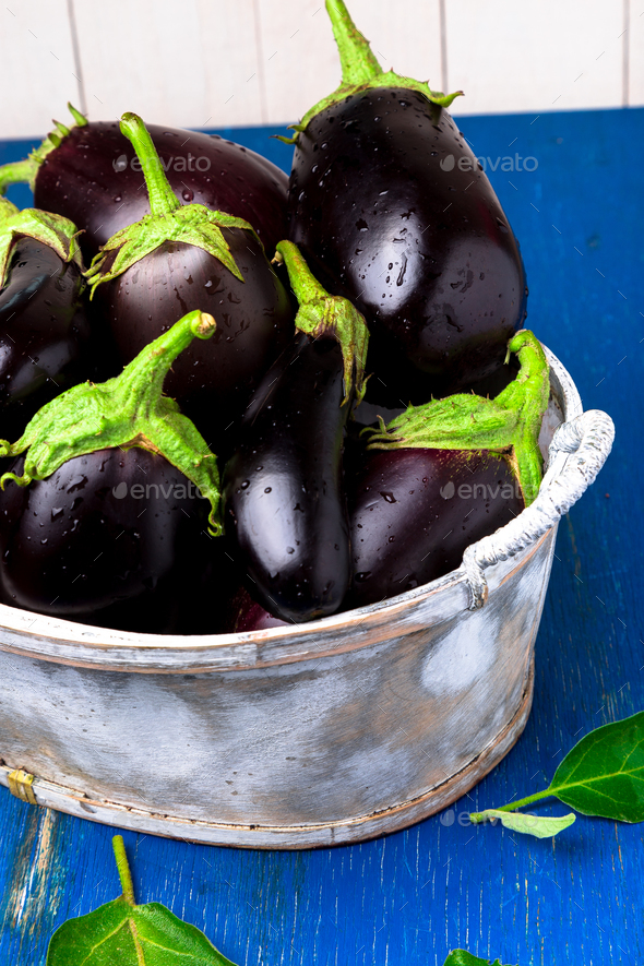 Fresh eggplant in grey basket - Stock Photo - Images