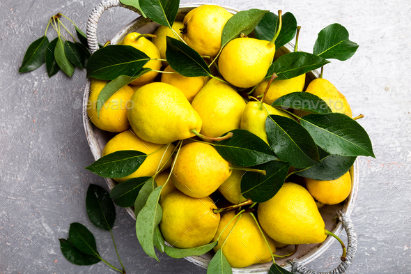 Yellow pear in grey basket - Stock Photo - Images