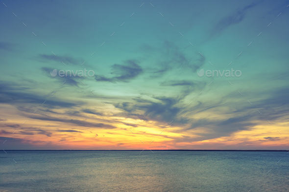 Aerial panoramic view of sunset over ocean - Stock Photo - Images