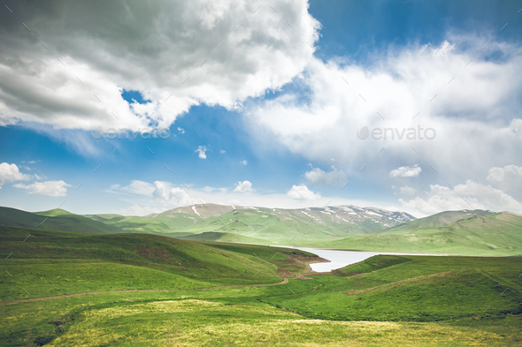 meadow, lake and blue sky - Stock Photo - Images