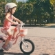 Happy Girl in Safety Helmet Riding a Bike in Park - VideoHive Item for Sale