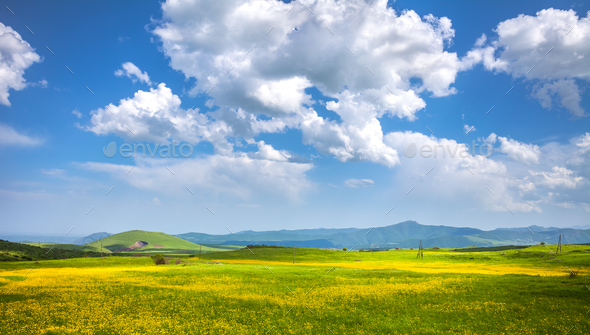 meadow, hills and blue sky - Stock Photo - Images