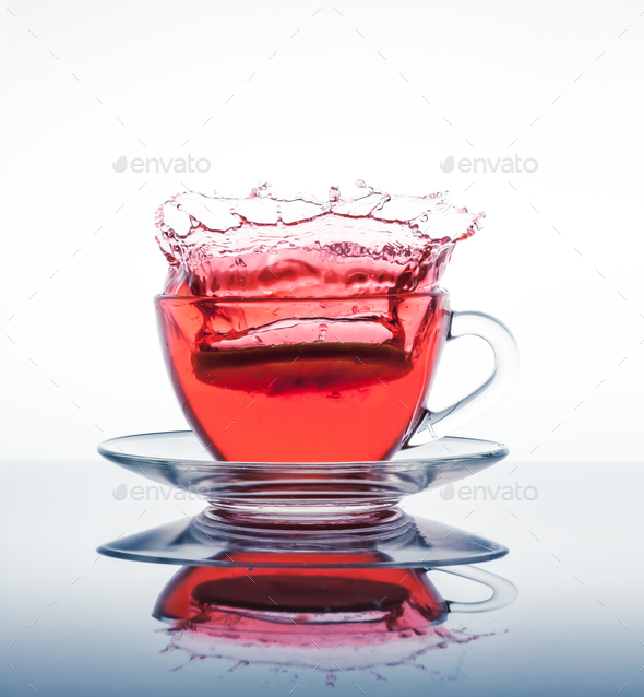 Cup of tea with splashes - Stock Photo - Images