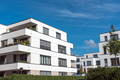 New white townhouses in front of a blue sky  - PhotoDune Item for Sale